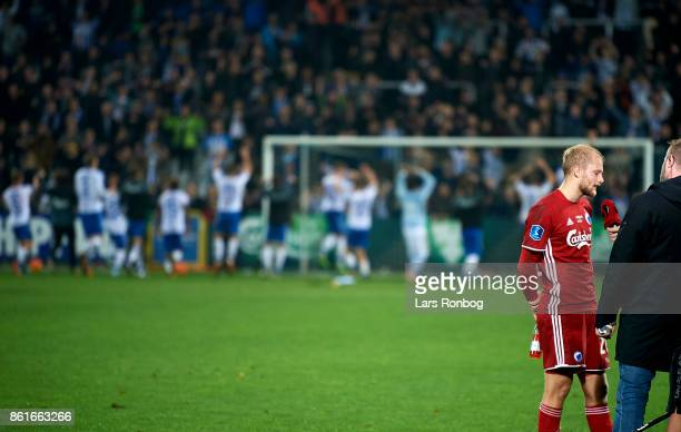 Nicolai Boilesen of FC Copenhagen speaks with the media while the players of OB odense celebrate with the fans after the Danish Alka Superliga match...