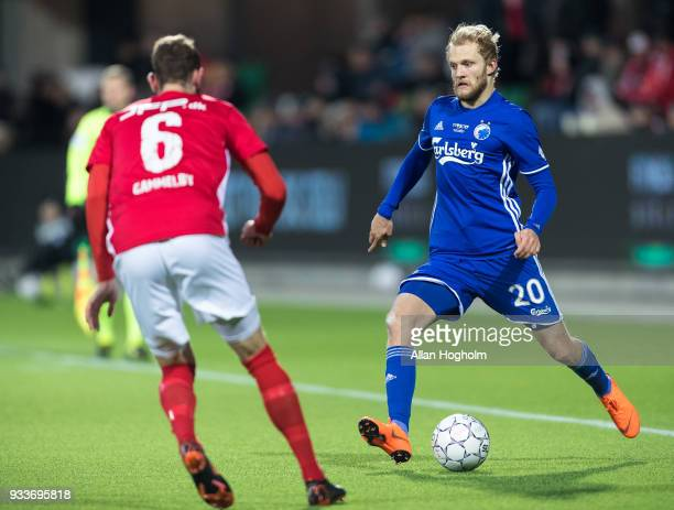 Nicolai Boilesen of FC Kobenhavn and Jens Martin Gammelby of Silkeborg IF compete for the ball during the Danish Alka Superliga match between...