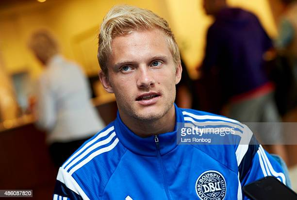 Nicolai Boilesen speaks to the media prior to the Denmark training session at Helsingor Stadion on August 31 2015 in Helsingor Denmark