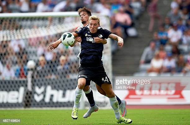 Nicolai BrockMadsen of Randers FC and Alexander Juel Andersen of AGF Aarhus compete for the ball during the Danish Alka Superliga match between AGF...