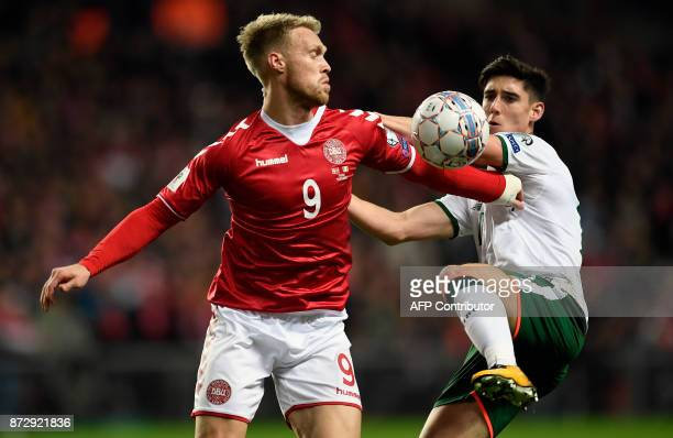 Nicolai Joergensen of Denmark vies for the ball against Callum O'Dowda of Ireland during the playoff FIFA World Cup 2018 qualification football match...