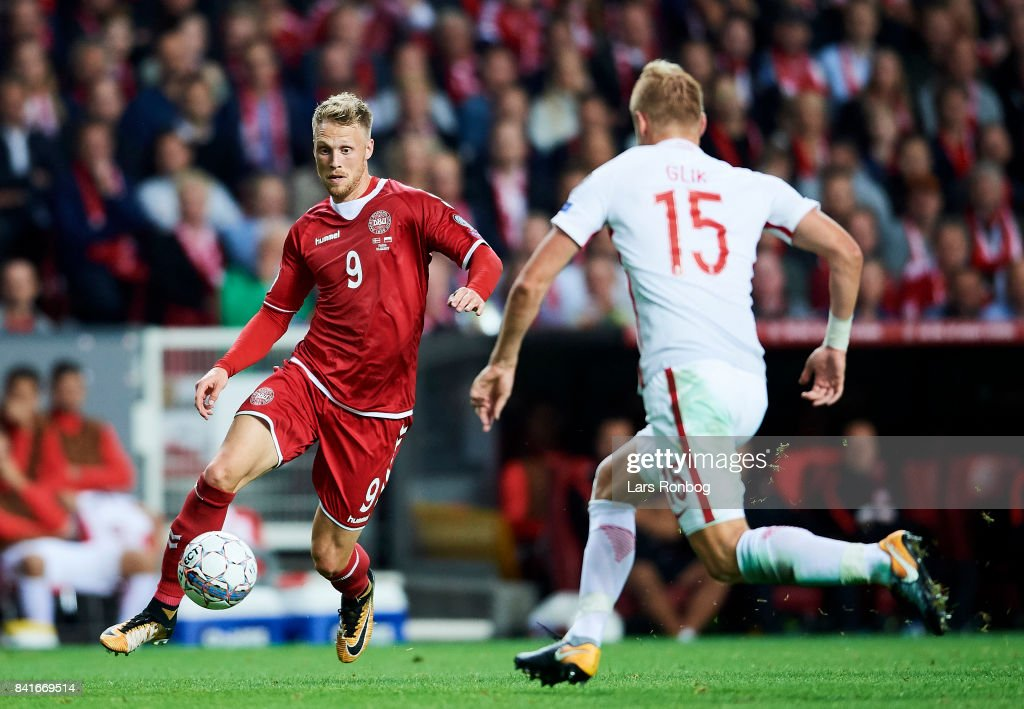 Nicolai Jorgensen of Denmark and Kamil Glik of Poland compete for the ball during the FIFA World Cup 2018 qualifier match between Denmark and Poland at Telia Parken Stadium on September 1, 2017 in Copenhagen, Denmark.