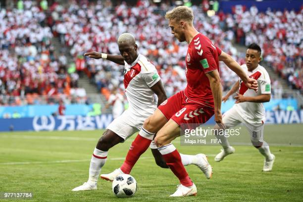Nicolai Jorgensen of Denmark and Luis Advincula of Peru battle for the ball during the 2018 FIFA World Cup Russia group C match between Peru and...