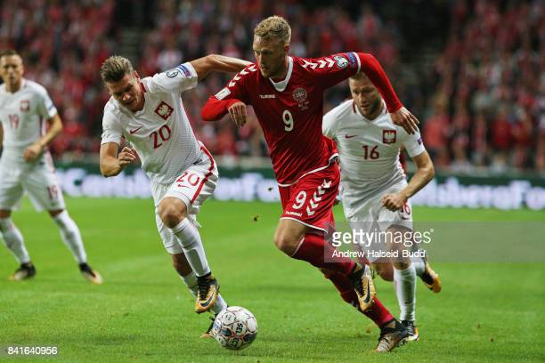 Nicolai Jorgensen of Denmark and Lukasz Piszczek of Poland in action during the FIFA 2018 World Cup Qualifier between Denmark and Poland at Parken...
