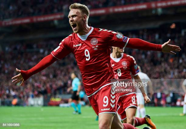 Nicolai Jorgensen of Denmark celebrates after scoring their third goal during the FIFA World Cup 2018 qualifier match between Denmark and Poland at...