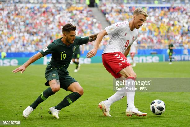 Nicolai Jorgensen of Denmark is challenged by Joshua Risdon of Australia during the 2018 FIFA World Cup Russia group C match between Denmark and...