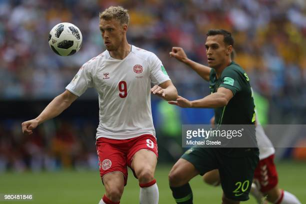 Nicolai Jorgensen of Denmark is tracked by Trent Sainsbury of Australia during the 2018 FIFA World Cup Russia group C match between Denmark and...