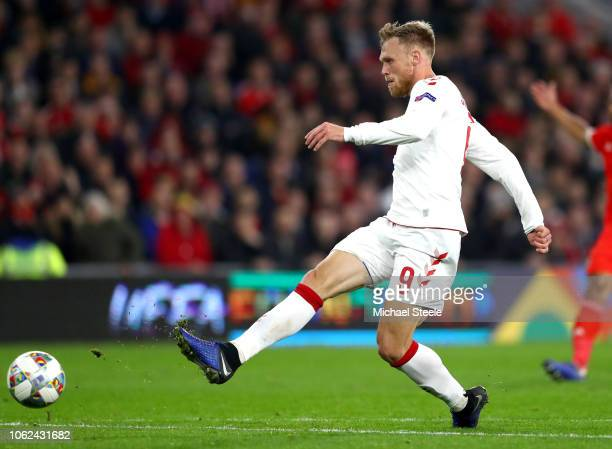 Nicolai Jorgensen of Denmark scores his team's first goal during the UEFA Nations League Group B match between Wales and Denmark at Cardiff City...