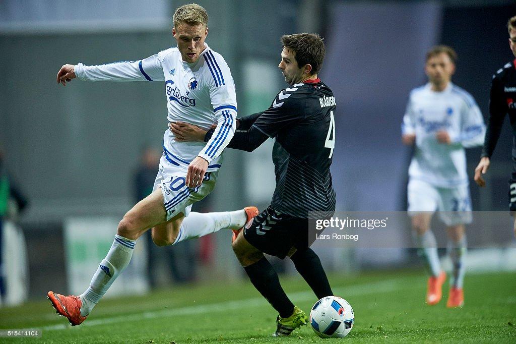 Nicolai Jorgensen of FC Copenhagen and Jakob Blabjerg of AaB Aalborg compete for the ball during the Danish Alka Superliga match between FC Copenhagen and AaB Aalborg at Telia Parken Stadium on March 13, 2016 in Copenhagen, Denmark.
