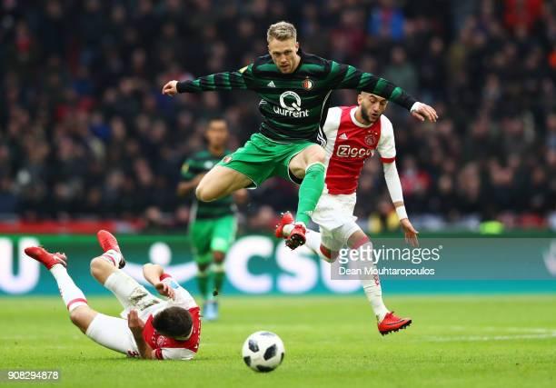 Nicolai Jorgensen of Feyenoord evades Joel Veltman and Hakim Ziyech of Ajax during the Dutch Eredivisie match between Ajax Amsterdam and Feyenoord at...