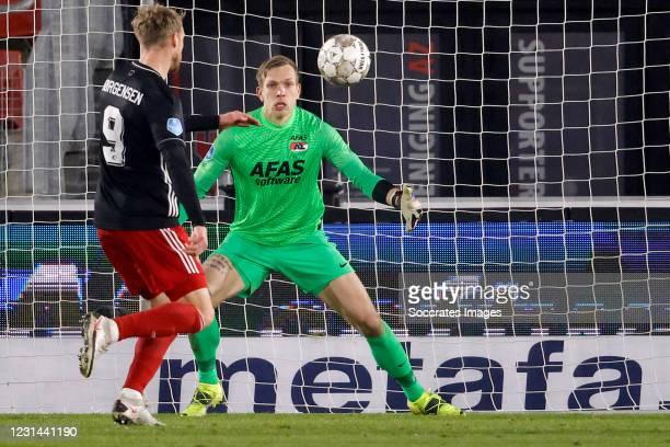Nicolai Jorgensen of Feyenoord, Marco Bizot of AZ Alkmaar during the Dutch Eredivisie match between AZ Alkmaar v Feyenoord at the AFAS Stadium on...