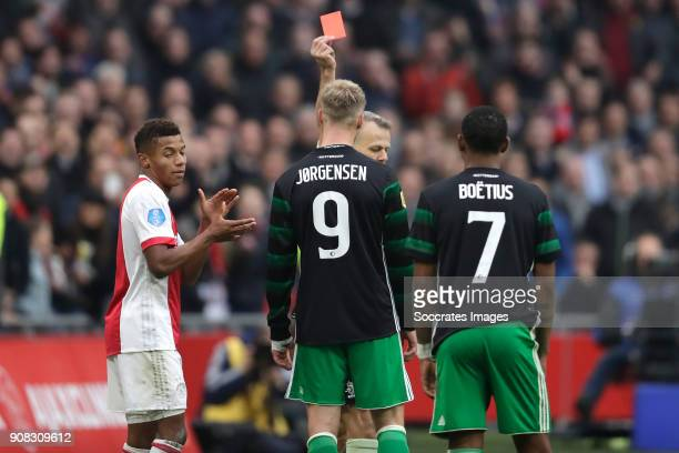 Nicolai Jorgensen of Feyenoord receives a red card from referee Bjorn Kuipers during the Dutch Eredivisie match between Ajax v Feyenoord at the Johan...