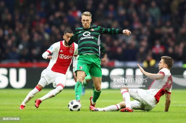 Nicolai Jorgensen of Feyenoord takes on Joel Veltman and Hakim Ziyech of Ajax during the Dutch Eredivisie match between Ajax Amsterdam and Feyenoord...