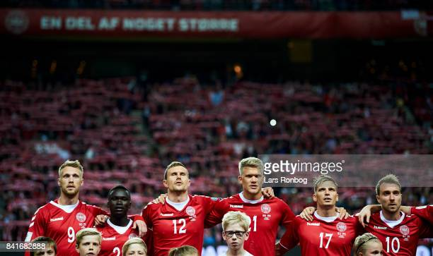 Nicolai Jorgensen Pione Sisto Andreas Bjelland Andreas Cornelius Jens Stryger Larsen and Christian Eriksen of Denmark during the national anthem...