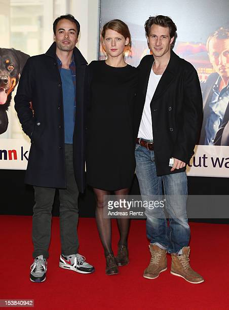 Nicolai Kinski Elena Rott and David Rott attend the 'Mann Tut Was Mann Kann' Germany Premiere at CineStar on October 9 2012 in Berlin Germany