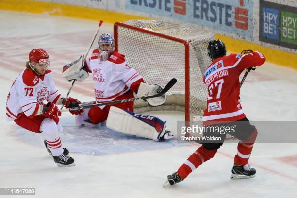 Nicolai Meyer of Denmark, Sebastian Dahm of Denmark and Thomas Hundertpfund of Austria during the Austria v Denmark - Ice Hockey International...