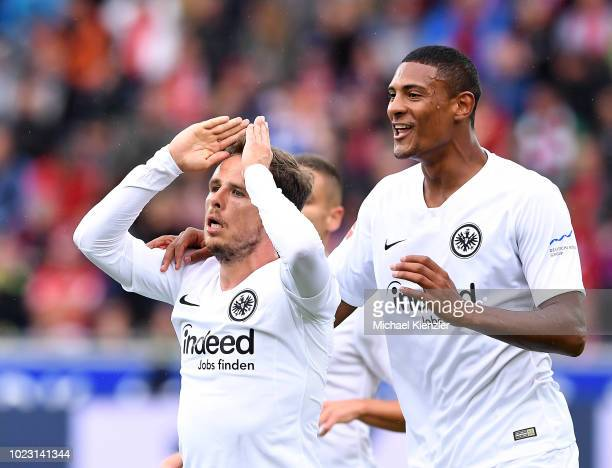 Nicolai Mueller and Sebastien Haller of Eintracht Frankfurt celebrate the goal of Nicolai Mueller during the Bundesliga match between Sport Club...