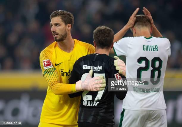 Nicolai Mueller Goalkeeper Kevin Trapp of Eintracht Frankfurt and Matthias Ginter of Borussia Moenchengladbach gesture during the Bundesliga match...