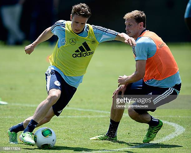 Nicolai Mueller is challenged by Benedikt Hoewedes during a training session at Barry University on May 24 2013 in Miami Florida
