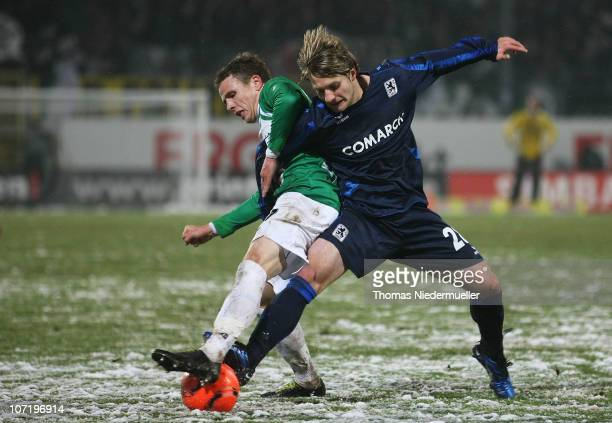 Nicolai Mueller of Fuerth fights for the ball with Daniel Halfar of Muenchen during the 2nd Bundesliga match between SpVgg Greuther Fuerth and 1860...