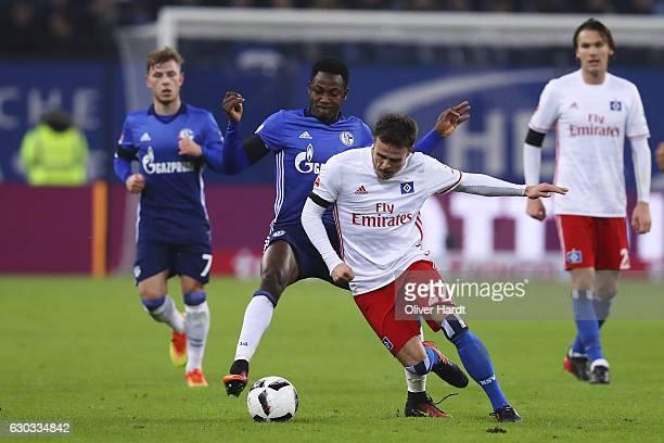 Nicolai Mueller of Hamburg and Abdul Rahman Baba of Schalke compete for the ball during the Bundesliga match between Hamburger SV and FC Schalke 04...