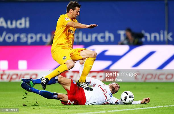Nicolai Mueller of Hamburg and David Abraham of Frankfurt battle for the ball during the Bundesliga match between Hamburger SV and Eintracht...