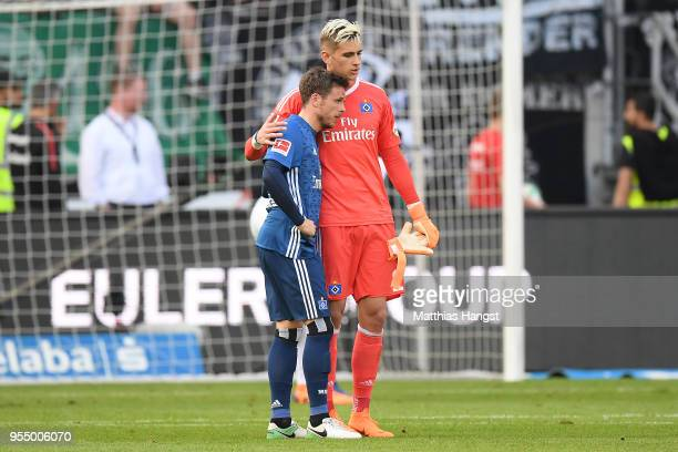 Nicolai Mueller of Hamburg and goalkeeper Julian Pollersbeck of Hamburg stand together dejected after the Bundesliga match between Eintracht...