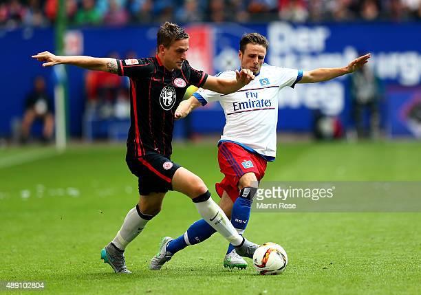 Nicolai Mueller of Hamburg and Haris Seferovic of Frankfurt battle for the ball during the Bundesliga match between Hamburger SV and Eintracht...