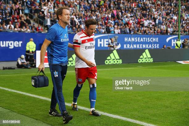 Nicolai Mueller of Hamburg injure after his scoring the opening goal during the Bundesliga match between Hamburger SV and FC Augsburg at...
