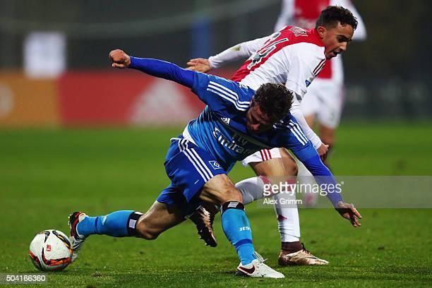 Nicolai Mueller of Hamburg is challenged by Nouri Abdelhak of Ajax of Ajax during a friendly match between Hamburger SV and Ajax Amsterdam at Gloria...