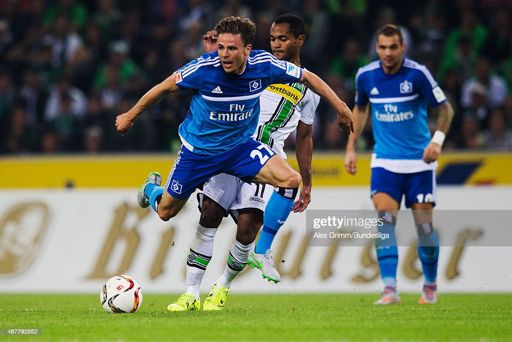 Nicolai Mueller (front) of Hamburg is challenged by Raffael of Moenchengladbach during the Bundesliga match between Borussia Moenchengladbach and Hamburger SV at Borussia-Park on September 11, 2015 in Moenchengladbach, Germany.