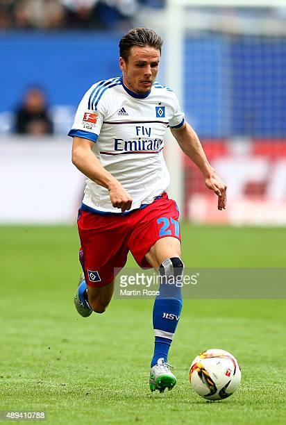 Nicolai Mueller of Hamburg runs with the ball during the Bundesliga match between Hamburger SV and Eintracht Frankfurt at Volksparkstadion on...