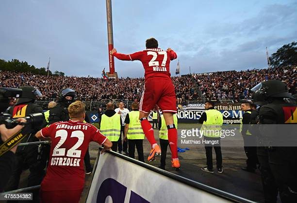 Nicolai Mueller of Hamburger SV celebrates as he scores their second goal during the Bundesliga play-off second leg match between Karlsruher SC and...