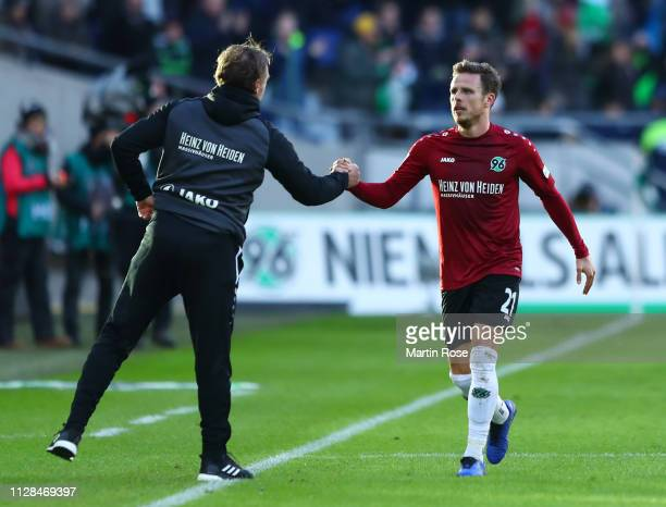 Nicolai Mueller of Hannover 96 celebrates after scoring his team's first goal with Thomas Doll Manager of Hannover 96 during the Bundesliga match...