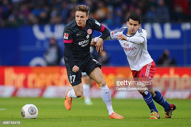 Nicolai Mueller of Mainz 05 and Tomas Rincon of Hamburger SV battle for the ball during the Bundesliga match between Hamburger SV and 1 FSV Mainz 05...
