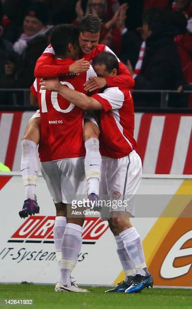 Nicolai Mueller of Mainz celebrates his team's third goal with team mates during the Bundesliga match between between FSV Mainz 05 and 1 FC Koeln at...