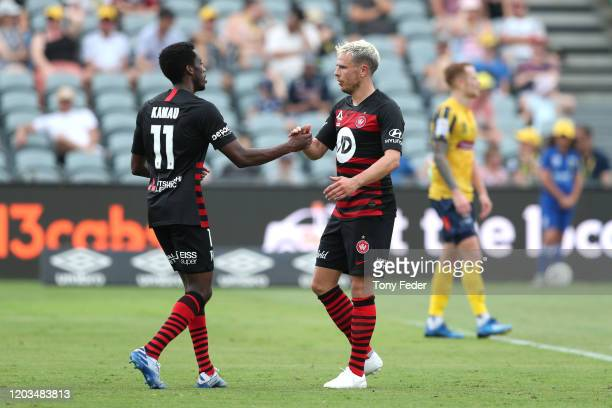 Nicolai Muller of Western Sydney Wanderers celebrates scoring a goal with team mate Bruce Kamau during the round 17 A-League match between the...