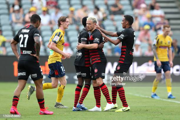 Nicolai Muller of Western Sydney Wanderers celebrates scoring a goal with team mates during the round 17 A-League match between the Central Mariners...