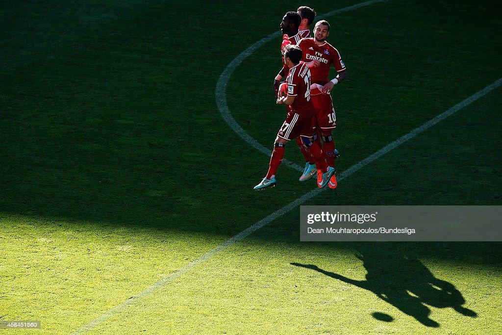 Nicolai Muller, Pierre-Michel Lasogga and Johan Djourou of Hamburg jump in the denfensive wall during the Bundesliga match between Borussia Dortmund and Hamburger SV at Signal Iduna Park on October 4, 2014 in Dortmund, Germany.