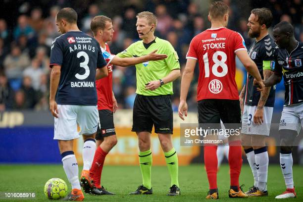 Nicolai Poulsen of Randers FC Referee Jorgen Daugbjerg Burchardt and Pierre Kanstrup of AGF Arhus in action during the Danish Superliga match between...