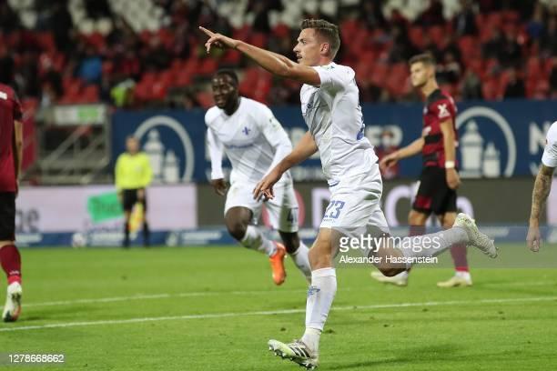Nicolai Rapp of Darmstadt celebrates scoring the winning goal during the Second Bundesliga match between 1. FC Nürnberg and SV Darmstadt 98 at...