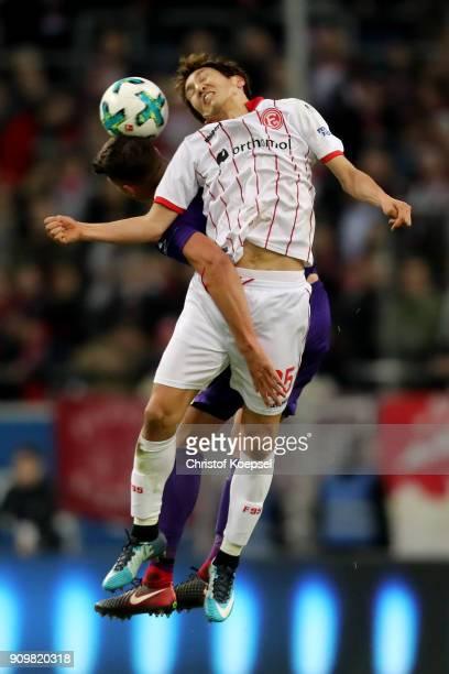 Nicolai Rapp of Erzgebirge Aue and Genki Haraguchi of Duesseldorf go up for a header during the Second Bundesliga match between Fortuna Duesseldorf...