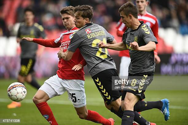 Nicolaj Ritter of Silkeborg IF Andrew Hjulsager of Brondby IF and Alexander Szymanowski of Brondby IF compete for the ball during the Danish Alka...