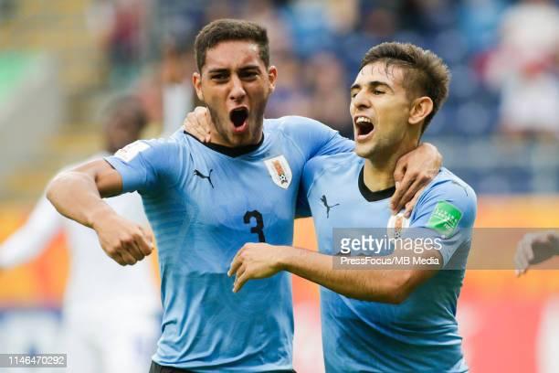 Nicolas Acevedo of Uruguay celebrates scoring a goal with Sebastian Caceres of Uruguay during the FIFA U20 World Cup match between Honduras and...