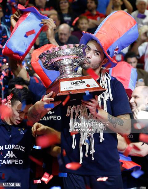 Nicolas Aguirre of San Lorenzo kisses the trophy to celebrate after winning the fifth game between San Lorenzo and Regatas as part of LNB 2017 Finals...