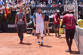 nicolas almagro leaves court injured during