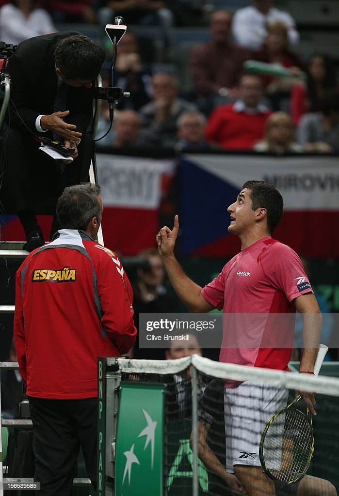Nicolas Almagro of Spain and his team captain Alex Corretja make a point to umpire Carlos Ramos during his match against Tomas Berdych of Czech Republic during day one of the final Davis Cup match between Czech Republic and Spain at the 02 Arena on November 16, 2012 in Prague, Czech Republic.