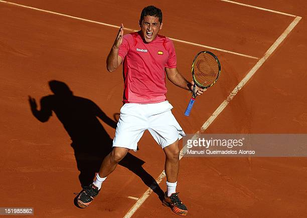 Nicolas Almagro of Spain celebrates a point over John Isner of the United States States during day one of the semi final Davis Cup between Spain and...