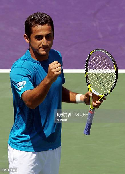 Nicolas Almagro of Spain celebrates after defeating Thomaz Bellucci of Brazil during day eight of the 2010 Sony Ericsson Open at Crandon Park Tennis...