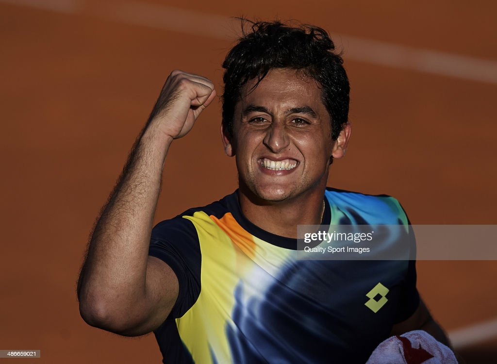 Nicolas Almagro of Spain celebrates defeating Rafael Nadal of Spain during day five of the ATP Barcelona Open Banc Sabadell at the Real Club de Tenis Barcelona on April 25, 2014 in Barcelona, Spain.